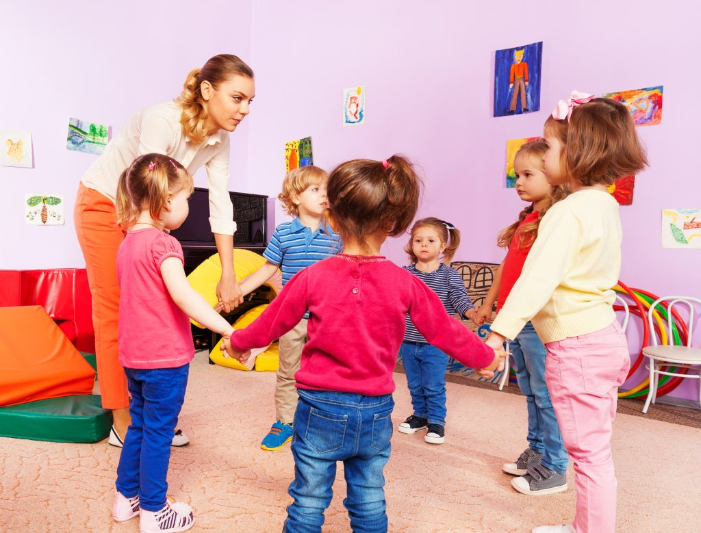 Early childhood education degree teacher teaching a class