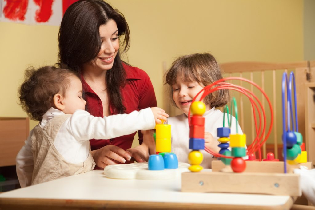 Female Early Education Teacher Working In Kindergarten